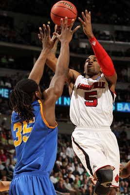 DENVER, CO - MARCH 17:  Chris Smith #5 of the Louisville Cardinals shoots the ball over Kenneth Faried #35 of the Morehead State Eagles during the second round of the 2011 NCAA men's basketball tournament at Pepsi Center on March 17, 2011 in Denver, Color