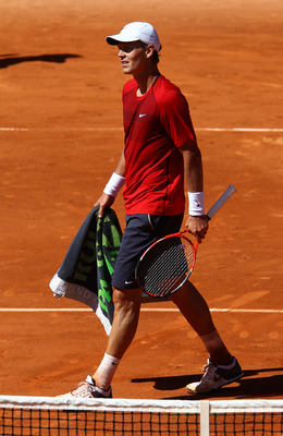 PARIS, FRANCE - MAY 23: Tomas Berdych of Czech Republic shows his dejection during the men's singles first round match between Tomas Berdych of Czech Republic and Stephane Robert of France on day two of the French Open at Roland Garros on May 23, 2011 in