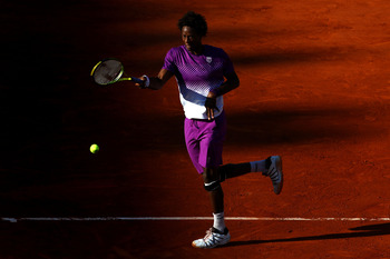 PARIS, FRANCE - MAY 31:  Gael Monfils of France hits a forehand during the men's singles quarterfinal match between Gael Monfils of France and Roger Federer of Switzerland on day ten of the French Open at Roland Garros on May 31, 2011 in Paris, France.  (