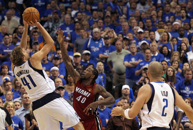 DALLAS, TX - JUNE 05:  Dirk Nowitzki #41 of the Dallas Mavericks attempts a shot against Udonis Haslem #40 of the Miami Heat in Game Three of the 2011 NBA Finals at American Airlines Center on June 5, 2011 in Dallas, Texas.  NOTE TO USER: User expressly a