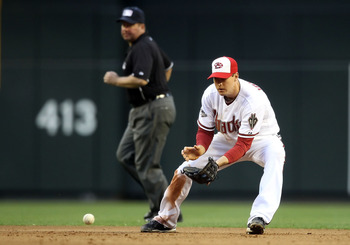 PHOENIX, AZ - MAY 30:  Infielder Kelly Johnson #2 of the Arizona Diamondbacks fields a ground ball out against the Florida Marlins during the Major League Baseball game at Chase Field on May 30, 2011 in Phoenix, Arizona.  The Diamondbacks defeated the Mar