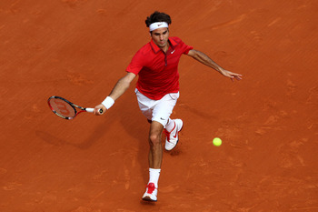 PARIS, FRANCE - JUNE 05:  Roger Federer of Switzerland hits a forehand during the men's singles final match between Rafael Nadal of Spain and Roger Federer of Switzerland on day fifteen of the French Open at Roland Garros on June 5, 2011 in Paris, France.