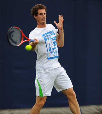 LONDON, ENGLAND - JUNE 06:  Andy Murray of Great Britain returns a shot during practice on day one of the AEGON Championships at Queens Club on June 6, 2011 in London, England.  (Photo by Michael Regan/Getty Images)