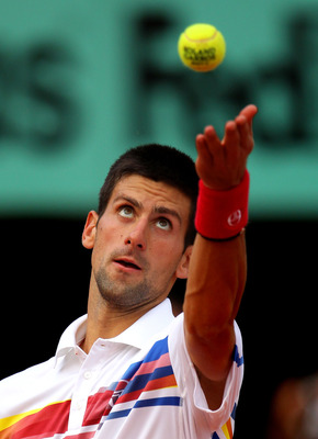 PARIS, FRANCE - JUNE 03:  Novak Djokovic of Serbia serves during the men's singles semi final match between Roger Federer of Switzerland and Novak Djokovic of Serbia on day thirteen of the French Open at Roland Garros on June 3, 2011 in Paris, France.  (P