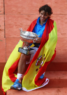 PARIS, FRANCE - JUNE 05:  Champion Rafael Nadal of Spain poses with the trophy following his victory during the men's singles final match between Rafael Nadal of Spain and Roger Federer of Switzerland on day fifteen of the French Open at Roland Garros on
