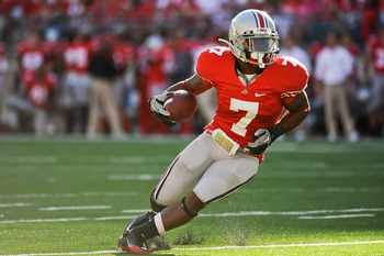 COLUMBUS, OH - SEPTEMBER 25:  Jordan Hall #7 of the Ohio State Buckeyes runs with the ball against the Eastern Michigan Eagles at Ohio Stadium on September 25, 2010 in Columbus, Ohio.  Ohio State won 73-20. (Photo by Jamie Sabau/Getty Images)