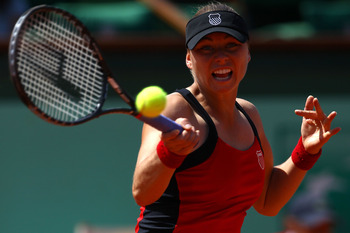 PARIS, FRANCE - MAY 29:  Vera Zvonareva of Russia hits a forehand during the women's singles round four match between Vera Zvonareva of Russia and Anastasia Pavlyuchenkova of Russia on day eight of the French Open at Roland Garros on May 29, 2011 in Paris
