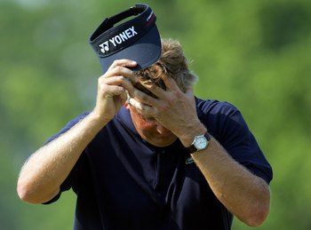 MAMARONECK, NY - JUNE 18:  Colin Montgomerie of Scotland shows his frustration on the ninth hole during the final round of the 2006 US Open Championship at Winged Foot Golf Club on June 18, 2006 in Mamaroneck, New York.  (Photo by Jamie Squire/Getty Image
