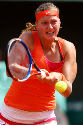 PARIS, FRANCE - MAY 30:  Petra Kvitova of Czech Republic hits a backhand during the women's singles round four match between Na Li of China and Petra Kvitova of Czech Republic on day nine of the French Open at Roland Garros on May 30, 2011 in Paris, Franc