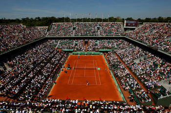 PARIS, FRANCE - MAY 23:  A general view of Court Phillippe Chatrier as Roger Federer of Switzerland serves during the men's singles first round match between Feliciano Lopez of Spain and Roger Federer of Switzerland on day two of the French Open at Roland
