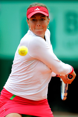 PARIS, FRANCE - MAY 31:  Anastasia Pavlyuchenkova of Russia plays a backhand during the women's singles quarterfinal match between Anastasia Pavlyuchenkova of Russia and Francesca Schiavone of Italy on day ten of the French Open at Roland Garros on May 31
