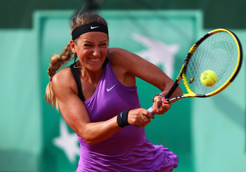 PARIS, FRANCE - MAY 30:  Victoria Azarenka of Belarus hits a backhand during the women's singles round four match between Ekaterina Makarova of Russia and Victoria Azarenka of Belarus on day nine of the French Open at Roland Garros on May 30, 2011 in Pari
