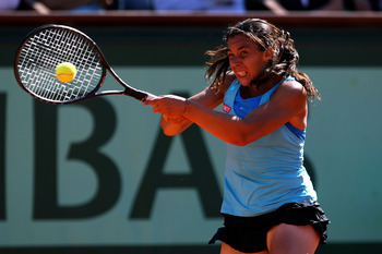 PARIS, FRANCE - JUNE 02:  Marion Bartoli of France hits a forehand during the women's singles semi final match between Marion Bartoli of France and Francesca Schiavone of Italy on day twelve of the French Open at Roland Garros on June 2, 2011 in Paris, Fr