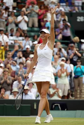 LONDON, ENGLAND - JUNE 26:  Maria Sharapova of Russia celebrates winning her match against Barbora Zahlavova Strycova of Czech Republic on Day Six of the Wimbledon Lawn Tennis Championships at the All England Lawn Tennis and Croquet Club on June 26, 2010