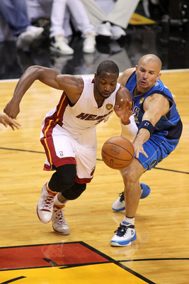 Dwyane Wade steals the ball from Jason Kidd