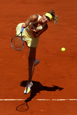 PARIS, FRANCE - JUNE 02:  Maria Sharapova of Russia serves during the women's singles semi final match between Na Li of China and Maria Sharapova of Russia on day twelve of the French Open at Roland Garros on June 2, 2011 in Paris, France.  (Photo by Alex