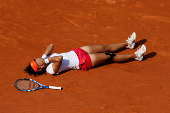 PARIS, FRANCE - JUNE 04:  Na Li of China celebrates matchpoint during the women's singles final match between Francesca Schiavone of Italy and Na Li of China on day fourteen of the French Open at Roland Garros on June 4, 2011 in Paris, France.  (Photo by
