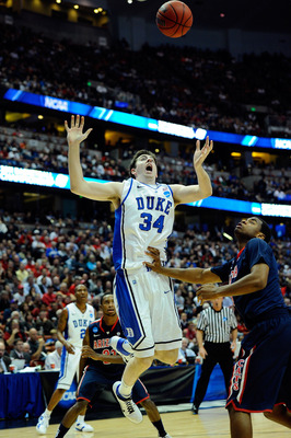 ANAHEIM, CA - MARCH 24:  Ryan Kelly #34 of the Duke Blue Devils looses control against Kevin Parrom #3 of the Arizona Wildcats during the west regional semifinal of the 2011 NCAA men's basketball tournament at the Honda Center on March 24, 2011 in Anaheim