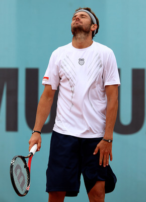 MADRID, SPAIN - MAY 12:  Mardy Fish of the USA  shows his dejection against Jurgen Melzer of Austria in their second round match during the Mutua Madrilena Madrid Open tennis tournament at the Caja Magica on May 12, 2010 in Madrid, Spain.  (Photo by Clive