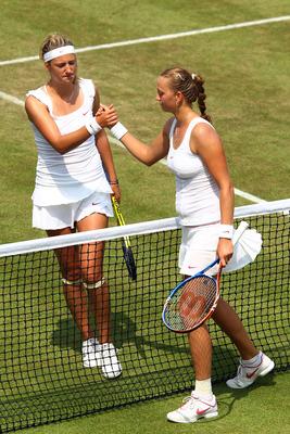 LONDON, ENGLAND - JUNE 26:  Petra Kvitova of Czech Republic (R) shakes hands after winning her match against Victoria Azarenka of Belarus on Day Six of the Wimbledon Lawn Tennis Championships at the All England Lawn Tennis and Croquet Club on June 26, 201