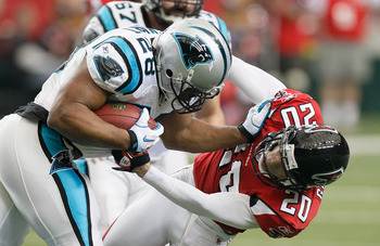 ATLANTA, GA - JANUARY 02:  Jonathan Stewart #28 of the Carolina Panthers stiff arms Brent Grimes #20 of the Atlanta Falcons at Georgia Dome on January 2, 2011 in Atlanta, Georgia.  (Photo by Kevin C. Cox/Getty Images)