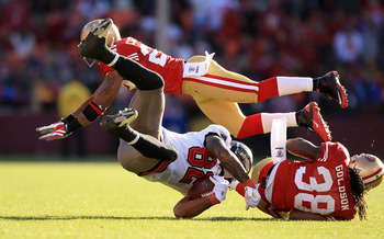 SAN FRANCISCO - NOVEMBER 21: Kellen Winslow #82 of the Tampa Bay Buccaneers is hit by Dashon Goldson #38 and Nate Clements #22 of the San Francisco 49ers at Candlestick Park on November 21, 2010 in San Francisco, California.  (Photo by Ezra Shaw/Getty Ima
