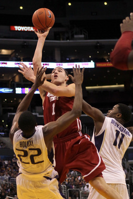 LOS ANGELES, CA - MARCH 10:  Klay Thompson #1 of the Washington State Cougars shoots over Justin Holiday #22 and Matthew Bryan-Amaning #11 of the Washington Huskies in the second half in the quarterfinals of the 2011 Pacific Life Pac-10 Men's Basketball T