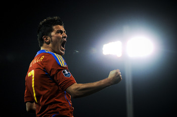 GRANADA, SPAIN - MARCH 25:  David Villa of Spain (R) celebrates after scoring his second goal during the UEFA EURO 2012 qualifier between Spain and Czech Republic at Los Carmenes Stadium on March 25, 2011 in Granada, Spain.  Spain win 2-1. (Photo by David