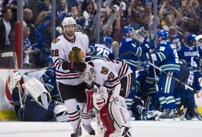 VANCOUVER, CANADA - APRIL 26: Troy Brouwer #22 consoles goalie Corey Crawford #50 of the Chicago Blackhawks after losing 2-1 in overtime to the Vancouver Canucks in Game Seven of the Western Conference Quarterfinals during the 2011 NHL Stanley Cup Playoff