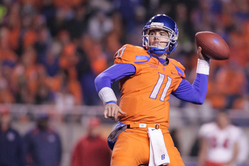 BOISE, ID - NOVEMBER 19:  Kellen Moore #11 of the Boise State Broncos passes against the Fresno State Bulldogs at Bronco Stadium on November 19, 2010 in Boise, Idaho.  (Photo by Otto Kitsinger III/Getty Images)
