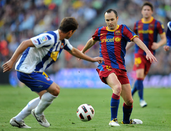 BARCELONA, SPAIN - MAY 08: Andres Iniesta (R) of Barcelona takes on an Espanyol player during the La Liga match between Barcelona and Espanyol at Nou Camp on May 8, 2011 in Barcelona, Spain.  (Photo by Denis Doyle/Getty Images)
