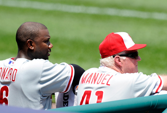 WASHINGTON, DC - MAY 30:  Manager Charlie Manuel #41 and Ryan Howard #6 of the Philadelphia Phillies watch the game against the Washington Nationals at Nationals Park on May 30, 2011 in Washington, DC.  (Photo by Greg Fiume/Getty Images)