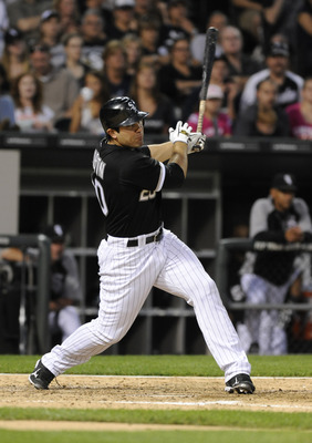 CHICAGO, IL - JUNE 03: Carlos Quentin #20 of the Chicago White Sox hits a three-run homer against the Detroit Tigers in the fourth inning on June 3, 2011 at U.S. Cellular Field in Chicago, Illinois.  (Photo by David Banks/Getty Images)