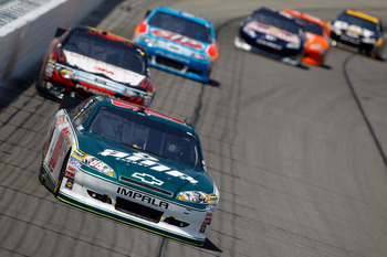 KANSAS CITY, KS - JUNE 05:  Dale Earnhardt Jr., driver of the #88 Amp Energy/National Guard Chevrolet, leads a group of cars during the NASCAR Sprint Cup Series STP 400 at Kansas Speedway on June 5, 2011 in Kansas City, Kansas.  (Photo by Todd Warshaw/Get