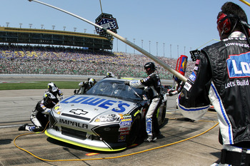 KANSAS CITY, KS - JUNE 05:  Jimmie Johnson pits the #48 Lowe's/Kobalt Tools Chevrolet during the NASCAR Sprint Cup Series STP 400 at Kansas Speedway on June 5, 2011 in Kansas City, Kansas.  (Photo by Tim Umphrey/Getty Images for NASCAR)