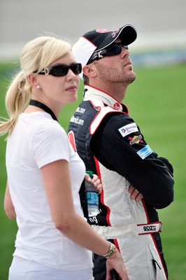 JOLIET, IL - JUNE 04:  Kevin Harvick, driver of the #33 Rheem Chevrolet, stands on the grid with wife DeLana, during qualifying for the NASCAR Nationwide Series STP 300 at Chicagoland Speedway on June 4, 2011 in Joliet, Illinois.  (Photo by Jason Smith/Ge