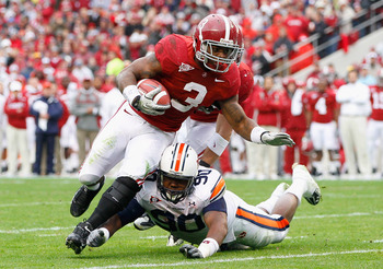 TUSCALOOSA, AL - NOVEMBER 26:  Trent Richardson #3 of the Alabama Crimson Tide is tackled by Nick Fairly #90 of the Auburn Tigers at Bryant-Denny Stadium on November 26, 2010 in Tuscaloosa, Alabama.  (Photo by Kevin C. Cox/Getty Images)