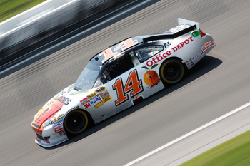 KANSAS CITY, KS - JUNE 05:  Tony Stewart, driver of the #14 The Glades/Office Depot Chevrolet, races during the NASCAR Sprint Cup Series STP 400 at Kansas Speedway on June 5, 2011 in Kansas City, Kansas.  (Photo by Geoff Burke/Getty Images for NASCAR)