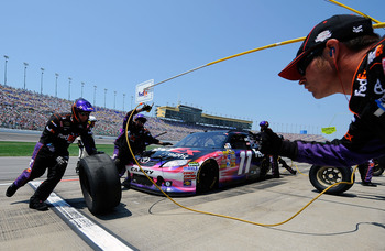 KANSAS CITY, KS - JUNE 05:  Denny Hamlin pits the #11 FedEx Freight Toyota during the NASCAR Sprint Cup Series STP 400 at Kansas Speedway on June 5, 2011 in Kansas City, Kansas.  (Photo by Jared C. Tilton/Getty Images for NASCAR)