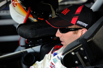 KANSAS CITY, KS - JUNE 03:  Greg Biffle, driver of the #16 3M/Walgreens Ford, sits in his car in the garage area during practice for the NASCAR Sprint Cup Series STP 400 at Kansas Speedway on June 3, 2011 in Kansas City, Kansas.  (Photo by John Harrelson/