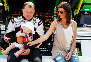 KANSAS CITY, KS - JUNE 05:  Ryan Newman, driver of the #39 Haas Automation Chevrolet, his wife Krissie Newman and their daughter Brooklyn Sage Newman sits together prior to the NASCAR Sprint Cup Series STP 400 at Kansas Speedway on June 5, 2011 in Kansas
