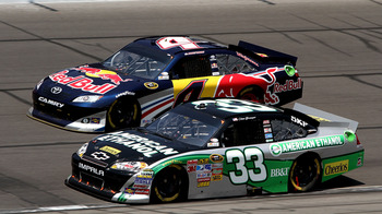 KANSAS CITY, KS - JUNE 05:  Clint Bowyer, driver of the #33 American Ethanol Chevrolet, races Kasey Kahne, driver of the #4 Red Bull Toyota, during the NASCAR Sprint Cup Series STP 400 at Kansas Speedway on June 5, 2011 in Kansas City, Kansas.  (Photo by