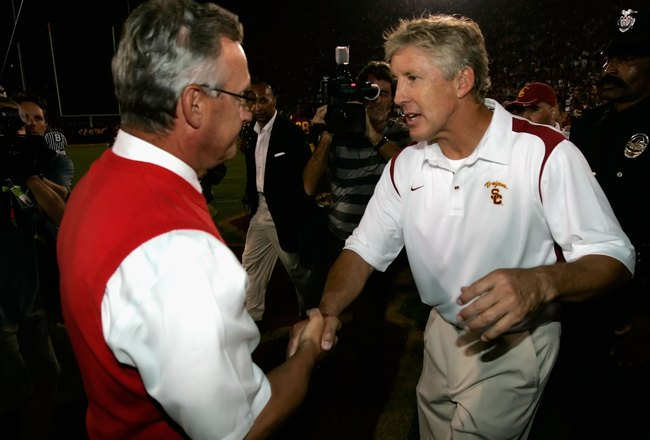 LOS ANGELES, CA - SEPTEMBER 13:  Head coach Jim Tressel of the Ohio State Buckeyes congratulates Pete Carroll of USC Trojans after the college football game at Los Angeles Memorial Coliseum on September 13, 2008 in Los Angeles, California. The Trojans def