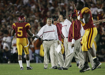 PASADENA, CA - JANUARY 04:  Head coach Pete Carroll of the USC Trojans congratulates running back Reggie Bush #5 after teammate LenDale White #21 scored on a 4-yard run against the Texas Longhorns in the first quarter during the BCS National Championship