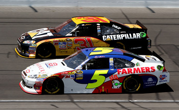 KANSAS CITY, KS - JUNE 05:  Mark Martin, driver of the #5 Farmers Insurance/GoDaddy.com Chevrolet, races Jeff Burton, driver of the #31 Caterpillar Chevrolet, during the NASCAR Sprint Cup Series STP 400 at Kansas Speedway on June 5, 2011 in Kansas City, K