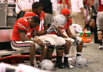 NEW ORLEANS - JANUARY 07:  Members of the Ohio State Buckeyes sit dejected after losing 38-24 to the Louisiana State University Tigers during the AllState BCS National Championship on January 7, 2008 at the Louisiana Superdome in New Orleans, Louisiana.