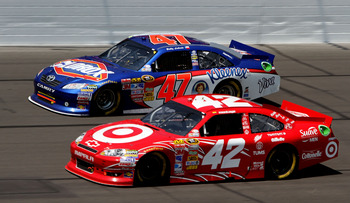 KANSAS CITY, KS - JUNE 05:  Juan Pablo Montoya, driver of the #42 Target Chevrolet, races Bobby Labonte, driver of the #47 Clorox/Kleenex Toyota, during the NASCAR Sprint Cup Series STP 400 at Kansas Speedway on June 5, 2011 in Kansas City, Kansas.  (Phot