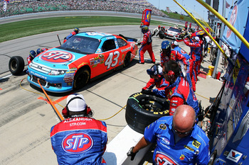 KANSAS CITY, KS - JUNE 05:  A.J. Allmendinger pits the #43 STP Ford during the NASCAR Sprint Cup Series STP 400 at Kansas Speedway on June 5, 2011 in Kansas City, Kansas.  (Photo by Tim Umphrey/Getty Images for NASCAR)