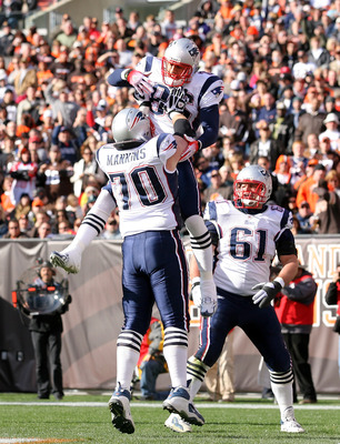 CLEVELAND - NOVEMBER 07:  Tight end Aaron Hernandez #85 of the New England Patriots celebrates with Logan Mankins #70 and Stephen Neal #61 after scoring a touchdown against the Cleveland Browns at Cleveland Browns Stadium on November 7, 2010 in Cleveland,