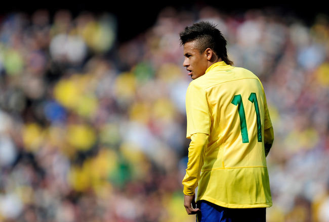 LONDON, ENGLAND - MARCH 27: Neymar of Brazil looks on during the International friendly match between Brazil and Scotland at Emirates Stadium on March 27, 2011 in London, England.  (Photo by Jamie McDonald/Getty Images)